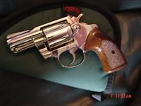 "Colt Detective Special,2"",fully refinished in bright nickel,wood grips,made in 1973,38 special,21 oz.looks like new"