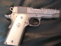 "Colt Commander,45acp,fully engraved slide,real ivory grips,1911,4 1/4"" barrel,polished stainless & brushed stainless,box,manual,lock,2 mags,etc,Series 80,2010.awesome showpiece !!"