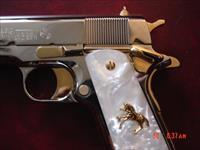 Colt Government 45, full refinished in bright mirror nickel with 24K gold accents,2 mags,pearlite grips,never fired,box,manual etc.an awesome showpiece !!