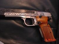 Smith & Wesson model 41,master engraved by the late Ben Shostle,2 tone,deep relief,wood grips, awesome work of art & signed by him