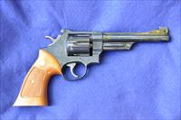 "S&W 27-2 6"" blue 95-96% original finish remaining, walnut target stocks 1/4"" smooth trigger, wide hammer, patridge front sight. Exc cond"