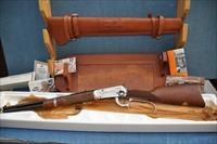 Model 94 John Wayne Commemorative 32-40, leather scabbard and tooled rifle rack