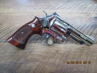 "SMITH & WESSON ""UNFIRED"" MODEL 29-3 NICKEL 44 MAGNUM 4"" BBL. AS NEW IN 99% PLUS ORIGINAL CONDITION . NO BOX"