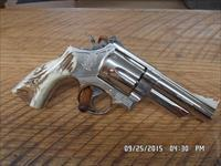 "SMITH & WESSON MODEL 29-2 (MFG 1980) 44 MAGNUM 4"" FACTORY NICKEL 99% PLUS ORIG.COND."