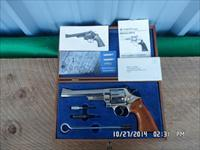 SMITH & WESSON 1975 MODEL 29-2 NICKEL 44 MAGNUM REVOLVER 99% ORIG.CONDITION WITH WOOD CASE AND ALL PAPERWORK AND TOOLS.