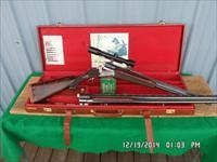 PETER MAHRHOLDT OVER/UNDER 2 BBL.MATCHING SET 30-06 / 12 GA. CLAW MOUNTED HENZOLT SCOPE ,CASED AND ALL 98% CONDITION.