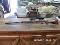 CUSTOM MAUSER 25-06 A.A.WHITE ENGRAVED,BUILT BY N.B.FASHINGBAUER STOCKMAKER AND METAL SMITH LEUPOLD ALL 99% CONDITION.