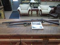 SPRINGFIELD MODEL 1873 TRAP DOOR RIFLE 45-70 GOV'T CAL. WITH BAYONET ,SCABBARD AND HARD COVER BOOK.