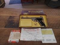 HIGH-STANDARD SK-100 SPORT KING (LIGHTWEIGHT)RARE NICKEL 22 L.R. PISTOL 99% WITH ORIGINAL BOX AND PAPERWORK.