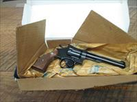 SMITH & WESSON (1984) REVOLVER  MODEL 17-4 ,22 L.R. CALIBER. 99% ORIGIAL CONDITION.NON ORIG.BOX.