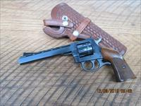 H & R MODEL 939 22L.R. CAL. 9 SHOT REVOLVER 99% ORIG.CONDITION WITH HAND MADE HOLSTER.