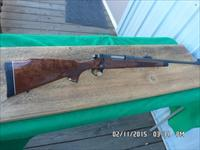REMINGTON MODEL 700 BDL DELUXE(RARE) 8MM REM.MAG. UNFIRED AND AS NEW ORIGINAL CONDITION!NO BOX