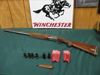 6176 Winchester 101 Pigeon XTR 12 gauge, 28 inch barrels, 6 winchester chokes, 2ic 2mod 2 full, wrench, 2 winchester pouches, freckled right side of receiver. TIGER STRIPED WALNUT, 98% condition.all original and tite.