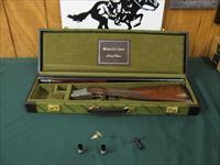 6543 Winchester 101 Quail Special 28 gauge, 26 inch barrels,4 chokes sk ic m f,wrench, keys, STRAIGHT GRIP, Winchester butt pad, all original, Winchester Quail Special case, vent rib ejectors,quail/dogs engraved coin silver receiver, AA++Fa