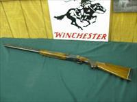 6107 Winchester 101 Field 20 gauge 28 inch barrels mod/full, vent rib ejectors, pistol grip with RED W,first 3 years of mfg, White line butt pad, 14 1/4 lop. all original and 97-98% conditon. 2 3/4 & 3 inch chambers,opens and closes tite.
