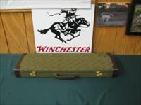 6739 Winchester 101 or model 23 case, leather trim, keys, compartment for chokes,etc, 90% condition, will take 28 inch barrels.