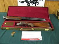 6322 Winchester 101 Pigeon XTR Lightweight 20 gauge 27 inch barrels 2 3/4 & 3 inch chamber, 2 screw in winchokes,ic/mod, more for $35, ejectors, vent rib round knob,pheasants/Quail game scene engraved coin silver receiver, Winchester pamphl