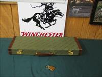 6751 Winchester 101 or 23 case will take 26 inch barrels,keys, leather trimmed.NEW OLD STOCK.