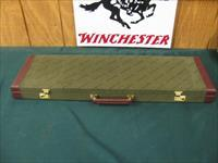 6331 Winchester 101 or 23 case, will take 32 inch barrels has the keys, leather trim  as new. hard to get in this length. as new