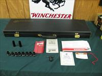 6165 Winchester 101 Waterfowler 12 guage 30 inch barrels, 8 win chokes 2sk ic 2im m f xf,wrench,pouch, hang tag, all papers, correct Winchester case all original, Winchester butt pad,bores brite and shiny, opens and closes tite,97% plus con