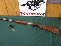 6338 Winchester 101 LIGHTWEIGHT 12 gauge 27 inch barrels, 6 chokes and wrench sk im 2mod ic full,vent rib, pheasants, quail and snipe engraved coin silver receiver, 99% condition, Winchester pad, all original, came wrapped in bed sheet. bor
