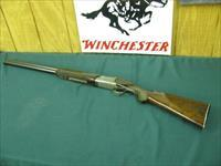 6130 Winchester 101 Pigeon 12 gauge 28 inch barrels, mod/full, all original and in 99% condition, this is the early one with dark walnut and diamond tipped engraver did the rose and scroll on the receiver, Winchester butt plate.AA Fancy Wal
