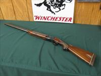 6404 Winchester 101 Field 20 ga 2 3/4 & 3 inch chambers, 28 inch barrels,mod/full, ejectors, vent rib, single select trigger,  99.9% as new, came from West Texas collection. A+ Fancy Walnut, one of the best.