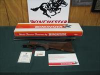 6804 Winchester 23 Classic 12 gauge 26 inch barrels, 2 3/4& 3 inch chambers, ejectors, vent rib, pistol grip with cap, Winchester butt pad, GOLD RAISE RELIEF PHEASANT ON BOTTOM OF RECEIVER, all papers hang tag etc.correct serialized box to
