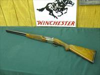 6132 Winchester 23 Pigeon XTR 12 gauge 26 inch barrels,ic/mod, 2 3/4 & 3 inch chambers, vent rib , round knob ejectors,single select trigger, butt pad, TIGER STRIPED FANCY WALNUT, AA++, rose and scroll engraved coin silver receiver. 99% con