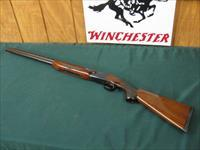 6321 Winchester 101 Field 20 gauge 2 3/4 & 3 inch chambers mod/full 28 inch barrels, pistol grip with cap, vent rib ejectors,Old English pad lop 13 3/4, opens and closes tite, bores/brite/shiney, nice straight grain walnut pattern.came from