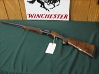6513 Winchester 23 Classic 410 gauge 26 barrels mod/full, vent rib ejectors, pistol grip with cap,Winchester butt pad, all original, GOLD RAISED RELIEF QUAIL on bottom of receiver, 99.9% condition, AA++FANCY HIGHLY FIGURED WALNUT IN STOCK A