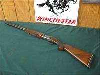 6320 Winchester 101 Pigeon 20 gauge 26 inch barrels ic/mod oil finish, white line butt pad 14 5/8 lop 99% condition, 3inch, vent rib ejectors, bores brite and shiny, opens and closes tite. very nice dark grain pattern.