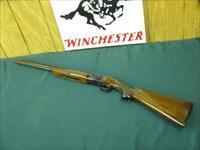 6080 Winchester field 410 gauge 26 inch barrels, ic/mod, vent rib, pistol grip with cap, ejectors,Winchester butt pad, ALL ORIGINAL, shot little, opens and closes tite, bores brite and shiny,one of a pair with #6079 the 28ga,both bought fro