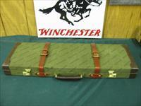 6215 Winchester 101 Pigeon LIGHTWEIGHT BABY FRAME 28 gauge 28 inch barrels STRAIGHT GRIP, 4 Briley chokes s ic m f, wrench,vent rib, quail engraved on coin silver receiver, Winchester buttpad,extra padl AA+Fancy Walnut. 99% condition. very