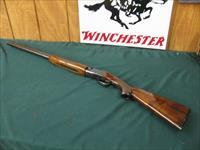 6295 Winchester 101 Field 20 gauge 26 inch barrels ic/mod,  2 3/4 & 3 inch chambers, 93% condition with usual hunting marks,all original with Winchester butt plate. opens and closes tite, bores are brite and shiny.