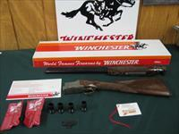 6233 Winchester 101 Quail Special 12 gauge 26 inch barrels, 2 3/4 & 3inch chambers, STAIGHT GRIP Winchester butt pad,vent rib ejectors,quail and dog engraved coin silver receiver, 99% condition, not a mark on it. correct Winchester box hang