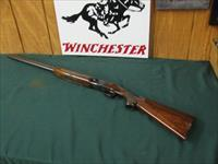 6699 Winchester 101 field 20 gauge 28 inch barrels 2 3/4 & 3 inch chambers, modd/full, bore/brite/shiny/.vent rib ejectors,pistol grip with cap, ALL ORIGINAL, Winchester butt plate, 97-98% condition, opens/closes tite, seldom used.very nice