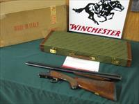 6519 Winchester 23 Classic BABY FRAME 28 gauge 26 barrels ic/mod,vent rib, ejectors, pistol grip with cap, butt pad, all original, BABY FRAME WITH AAA Fancy walnut, Winchester hard case,Winchester pamphlet,original mailing carton for case.