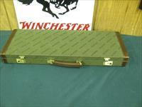 7016 Winchester 23 Classic 20 gauge 26 inch barrels ic/mod, vent rib, pistol grip with cap, ejectors, single select trigger, GOLD raised relief pheasant on bottom of receiver, correct Winchester butt pad,correct Winchester case with keysCOR