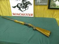 6874 Winchester 101 field 20 gauge 28 inch barrles mod/full, Red W pistol grip cap, 1st 3 years of mfg. Winchester butt plate,bores/brite/shiny, opens/closes/tite. 97% condition. nice straight grain walnut stock.