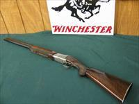 6291 Winchester 101 Pigeon 12 gauge 26 inch barrels ic/mod. this is the early highly desired Pigeon model with dark TIGER STRIPED WALNUT,and diamond tipped tools used to engrave the coin silver rose and scroll receiver.vent rib round knob b