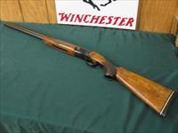 6255 Winchester 101 field 20 gauge 28 inch barrels skeet/skeet, 98% condition, seldom used, Pachmayer pad 14 1/2 lop,opens and closes tite, bores brite and shiny. 2 3/4 chambers. refinished wood. 98% condition