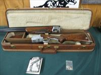 6257 Browning Citori Grade 5 1981 mfg,hand engraved, 12 gauge, 28 barrels, mod/full, long tang silver receiver, 3 pheasants one side duck other,98-99 % condition, HAND ENGRAVED, THIS IS THE RARE ONE,correct Browning case keys pamphlet, AA+