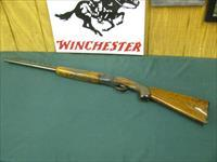 6932 Winchester 101 Field 20 gauge 26 inch barrels ic/mod, pistol grip with cap, all original, ejectors, Winchester butt plate, single brass front bead, TIGER STRIPPED FIGURED WALNUT STOCK, 95% condition. opens closes tite, bores/brite/shin