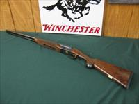 6514 Winchester 23 Classic 20 gauge 2 3/4 & 3inch chambers, ic/mod, pistol grip, vent rib ejectors, all original 99.9% AA++Fancy Walnut. Gold raised relief pheasant on bottom of receiver.Ebony insert in forend, bores brite/shiny opens close
