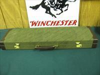6082 Winchester 23 Pigeon XTR 20 gauge, 26 inch barrels,4 ,correct Winchester case.AAFancy Walnut figure, one of the prettiest i have seen, round knob, vent rib, ejectors,Winchester butt pad, all original.only made from june-dec 1987. very