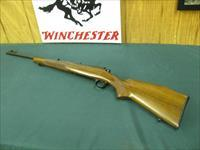 6968 Winchester Model 70 FEATHERWEIGHT 243 cal. 22 inch barrel, Hooded front site, sling swivels, butt plate, mfg 1959 PRE 64, 97-98% condition.all original and in excellent collector condition.
