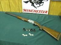 6237 Ruger RED LABEL 20 gauge 26 inch barrels, 2 3/4& 3 inch chambers, 7 chokes 3sk ic mod 2f,2 wrenches,silver receiver, opens and closes title, Decelerator Pad 14 1/2 LOP, A++Fancy Walnut,ejectors, vent rib,bores brite and shiny.very pret