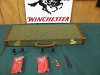 6940 Winchester model Pigeon XTR 12 gauge 27 barrels, 6 winchokes, sk,ic,mod,im,f,xf,2 pouches, wrench, keys, all complete and original 98% condition, Winchester case, Winchester butt pad, rose and scroll coin silver engraved receiver. this