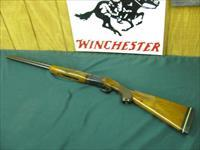 6145 Winchester 101 Field 20 gauge 27 inch barrels skeet/skeet, RED W, first 3 years of mfg.vent rib ejectors, bores brite and shiny, butt pad lop 14 1/2, opens and closes tite, seldom shot. 2 3/4 & 3 inch chambers.97 % condition